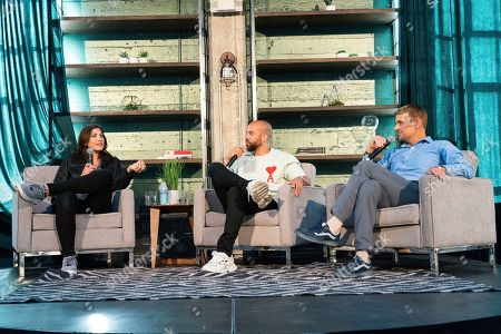 Stock Image of Hope Solo, Kobie Fuller, Trevor Moawad. Hope Solo, from left, Kobie Fuller and Trevor Moawad seen on day two of Summit LA19 in Downtown Los Angeles, in Los Angeles