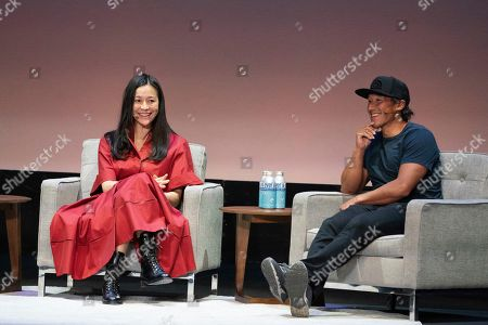 Stock Photo of Elizabeth Chai Vasarhelyi, Jimmy Chin. Elizabeth Chai Vasarhelyi, left, and Jimmy Chin seen on day two of Summit LA19 in Downtown Los Angeles, in Los Angeles