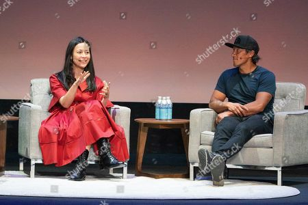 Stock Picture of Elizabeth Chai Vasarhelyi, Jimmy Chin. Elizabeth Chai Vasarhelyi, left, and Jimmy Chin seen on day two of Summit LA19 in Downtown Los Angeles, in Los Angeles