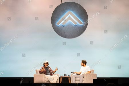Stock Photo of Hamdi Ulukaya, Elliott Bisnow. Hamdi Ulukaya, left, and Elliott Bisnow seen on day two of Summit LA19 in Downtown Los Angeles, in Los Angeles
