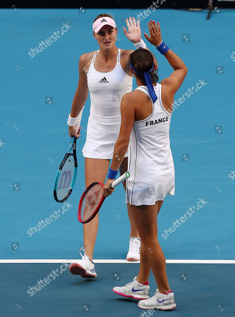 Kristina Mladenovic and Caroline Garcia of France celebrate winning the first set during the doubles match against Ash Barty and Sam Stosur of Australia on day 2 of the Fed Cup Final tennis competition between Australia and France at RAC Arena in Perth, Australia, 10 November 2019.