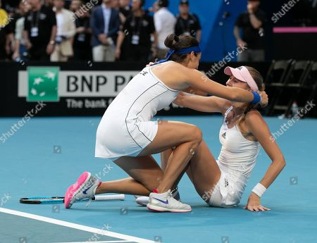 Caroline Garcia and Kristina Mladenovic of France celebrate winning the doubles match against Ash Barty and Sam Stosur of Australia on day 2 of the Fed Cup Final tennis competition between Australia and France at RAC Arena in Perth, Australia, 10 November 2019.