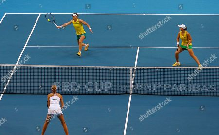 Sam Stosur (L) of Australia in action partnered with Ash Barty during the doubles match against Caroline Garcia and Kristina Mladenovic of France on day 2 of the Fed Cup Final tennis competition between Australia and France at RAC Arena in Perth, Australia, 10 November 2019.