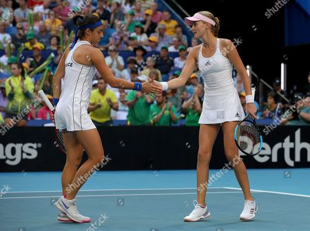 Caroline Garcia and Kristina Mladenovic of France congratulate each other during the doubles match against Ash Barty and Sam Stosur of Australia on day 2 of the Fed Cup Final tennis competition between Australia and France at RAC Arena in Perth, Australia, 10 November 2019.