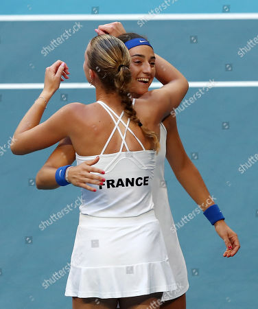 Stock Image of Caroline Garcia and Kristina Mladenovic of France celebrate winning the doubles match against Ash Barty and Sam Stosur of Australia on day 2 of the Fed Cup Final tennis competition between Australia and France at RAC Arena in Perth, Australia, 10 November 2019.