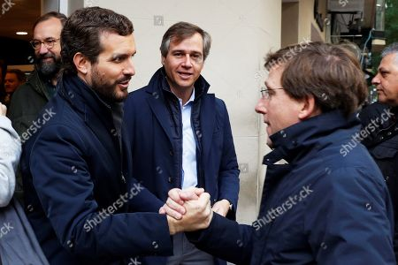 Madrid's Mayor Jose Luis Rodriguez Almeida (R) greets leader of Spanish People's Party (PP) Pablo Casado (L) after casting their votes at a polling station in Madrid, Spain, 10 November 2019. Spain holds general elections after acting Prime Minister Sanchez failed to form government following 28 April elections.