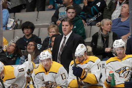 Nashville Predators head coach Peter Laviolette, center, watches during an NHL hockey game against the San Jose Sharks in San Jose, Calif