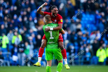 Ashley Williams of Bristol City celebrates with Daniel James Bentley after beating Cardiff City
