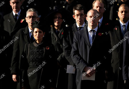 British lawmakers Priti Patel and Dominic Raab attend the Remembrance Sunday ceremony at the Cenotaph in Whitehall in London,. Remembrance Sunday is held each year to commemorate the service men and women who fought in past military conflicts