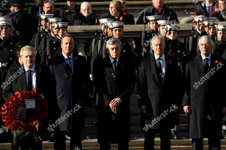 British Prime Minister Boris Johnson, left, and former British Prime Ministers, David Cameron, Gordon Brown, Tony Blair and Sir John Major, attend the Remembrance Sunday ceremony at the Cenotaph in Whitehall in London,. Remembrance Sunday is held each year to commemorate the service men and women who fought in past military conflicts