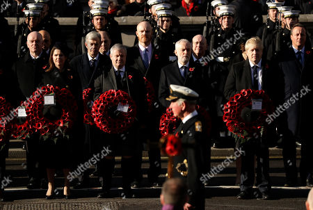 Jo Swinson, leader of the Liberal Democrats, Ian Blackford, the leader of the Scottish National Party in the House of Commons, Leader of the Labour Party Jeremy Corbyn and British Prime Minister Boris Johnson, from left, watch as Britain's Prince Charles prepares to lay a wreath at the Remembrance Sunday ceremony at the Cenotaph in Whitehall in London,. Remembrance Sunday is held each year to commemorate the service men and women who fought in past military conflicts