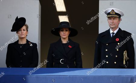 Meghan Duchess of Sussex, center, Sophie Countess of Wessex and Vice Admiral Sir Tim Laurence attend the Remembrance Sunday ceremony at the Cenotaph in Whitehall in London,. Remembrance Sunday is held each year to commemorate the service men and women who fought in past military conflicts