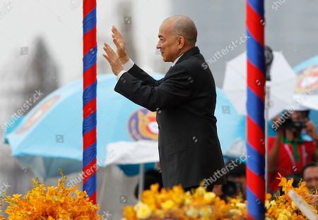 Cambodian King Norodom Sihamoni greets rowers during the annual Water Festival boat racing event on the Tonle Sap River in Phnom Penh, Cambodia, 10 November 2019. The annual Water Festival runs from 10 to 12 November and features around 300 racing boats, mostly from Cambodian provinces along the Mekong River.