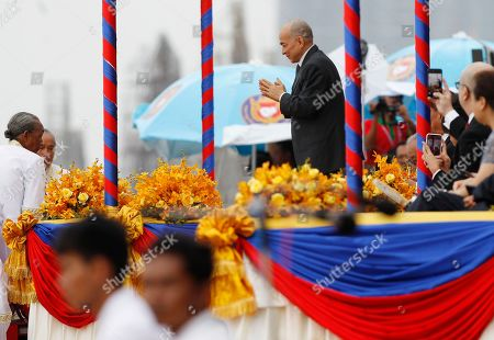 Cambodian King Norodom Sihamoni (C-R) attends the annual Water Festival boat racing event on the Tonle Sap River in Phnom Penh, Cambodia, 10 November 2019. The annual Water Festival runs from 10 to 12 November and features around 300 racing boats, mostly from Cambodian provinces along the Mekong River.