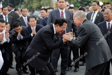 Cambodian Prime Minister Hun Sen (C-L) greets Cambodian King Norodom Sihamoni (C-R) during the annual Water Festival boat racing event on the Tonle Sap River in Phnom Penh, Cambodia, 10 November 2019. The annual Water Festival runs from 10 to 12 November and features around 300 racing boats, mostly from Cambodian provinces along the Mekong River.