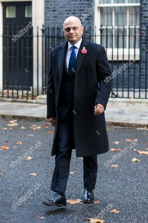 Stock Photo of Chancellor of the Exchequer Sajid Javid walks through Downing Street to attend the Remembrance Sunday Ceremony at the Cenotaph in Whitehall. Remembrance Sunday events are held across the country today as the UK remembers and honours those who have sacrificed themselves in two world wars and other conflicts.