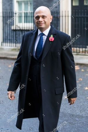 Chancellor of the Exchequer Sajid Javid walks through Downing Street to attend the Remembrance Sunday Ceremony at the Cenotaph in Whitehall. Remembrance Sunday events are held across the country today as the UK remembers and honours those who have sacrificed themselves in two world wars and other conflicts.