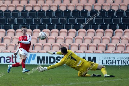 Ashley Hunter of Fleetwood Town scores the second goal past Scott Loach of Barnet during Barnet vs Fleetwood Town, Emirates FA Cup Football at the Hive Stadium on 10th November 2019