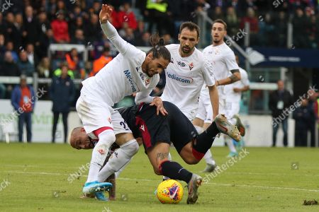 Stock Image of Cagliari's Radja Nainggolan (L) and Fiorentina's Martin Caceres (R) in action during the Italian Serie A soccer match Cagliari Calcio vs ACF Fiorentina at Sardegna Arena stadium in Cagliari, Sardinia island, Italy, 10 November 2019.