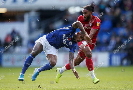 Leandro Bacuna of Cardiff City is tackled by Ashley Williams of Bristol City in the air.
