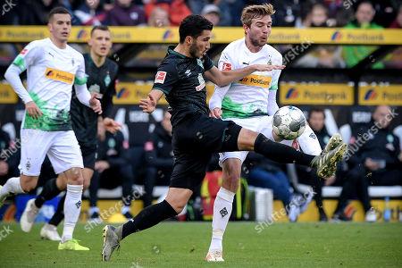 Bremen's Nuri Sahin (C) in action against Moenchengladbach's Christoph Kramer (R) during the German Bundesliga soccer match between Borussia Moenchengladbach and Werder Bremen in Moenchengladbach, Germany, 10 November 2019.