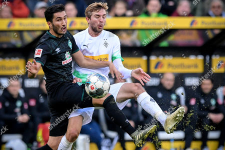 Bremen's Nuri Sahin (L) in action against Moenchengladbach's Christoph Kramer (R) during the German Bundesliga soccer match between Borussia Moenchengladbach and Werder Bremen in Moenchengladbach, Germany, 10 November 2019.