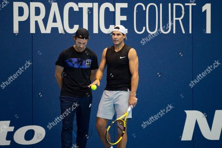Rafael Nadal of Spain and coach Carlos Moya during a practice session at the Nitto ATP Finals at the O2 Arena, London