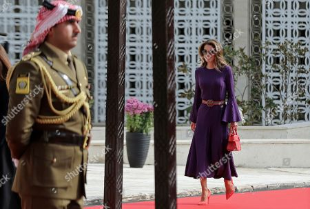 """Jordan's Queen Rania arrives for the opening of Parliament in Amman, Jordan,. During a speech to Parliament, King Abdullah II announced """"full sovereignty"""" over two pieces of land leased by Israel, ending a 25-year arrangement spelled out in the countries' landmark peace agreement. The king said Sunday that Jordan would end the """"annex of the two areas, Ghumar and Al-Baqoura, in the peace treaty and impose our full sovereignty on every inch of them"""