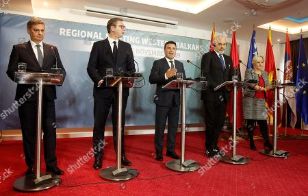 From left, Chairman of the Council of Ministers of Bosnia and Herzegovina Denis Zvizdic, Serbia's President Aleksandar Vucic, North Macedonia's Prime Minister Zoran Zaev, Albania's Prime Minister Edi Rama and Montenegro's Economy Minister Dragica Sekulic attend a joint news conference, following the Western Balkan leaders' meeting in the southwestern town of Ohrid, North Macedonia,. Western Balkan leaders say they are committed to work closely and to remove administrative barriers for free movement of goods and people between their countries