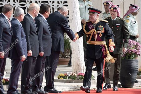 Stock Image of Jordan King Abdullah II (4-R) and Crown Prince Crown Prince Al Hussein bin Abdullah II (2-R)  greet Senate President Faisal al-Fayez and other officials upon their arrival for the opening ceremony of the fourth ordinary session of the 18th Parliament in Amman, Jordan, 10 November 2019.The Jordanian king gave his traditional annual throne speech to open the Parliament's Fourth ordinary session, which marks the start of legislative year in the country.
