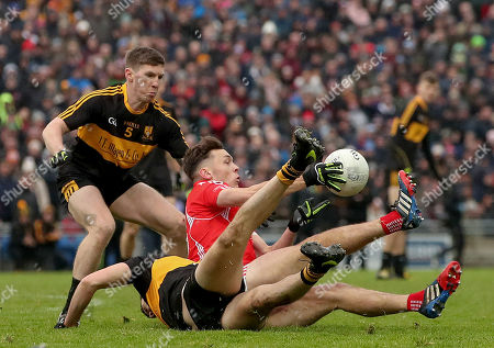 Stock Image of East Kerry vs Dr. Crokes. East Kerry's David Clifford is tackled by David O'Leary and Michael Moloney of Dr Crokes