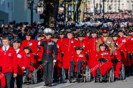 Chelsea pensioners with Johnson Beharry VC, 1st Bn, The Princess of Wales's Royal Regiment - The veterans march past to applause from the crowd - The Remembrance Sunday Parade at the Cenotaph in Whitehall to pay tribute to the casualties of war and, included for the first time this year, victims of terrorism.