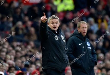 Manchester United's manager Ole Gunnar Solskjaer gives instructions to his players during the English Premier League soccer match between Manchester United and Brighton and Hove Albion, at the Old Trafford stadium in Manchester, England