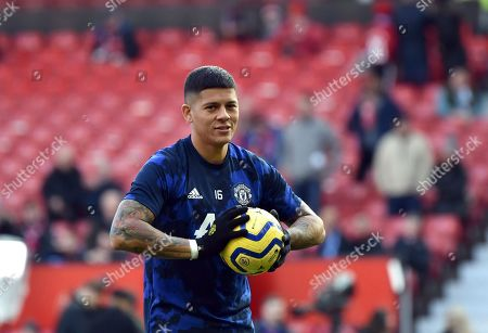 Manchester United's Marcos Rojo smiles during warm up before the English Premier League soccer match between Manchester United and Brighton and Hove Albion, at the Old Trafford stadium in Manchester, England