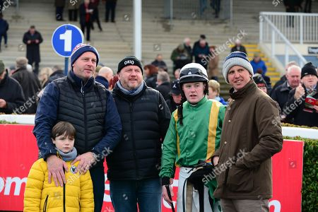 NAVAN. Owners of THEATRE WORLD, Rob, Gary and young Ruben Monroe watch the replay with jockey Luke Dempsey and trainer Ross O'Sullivan (right) after their win.