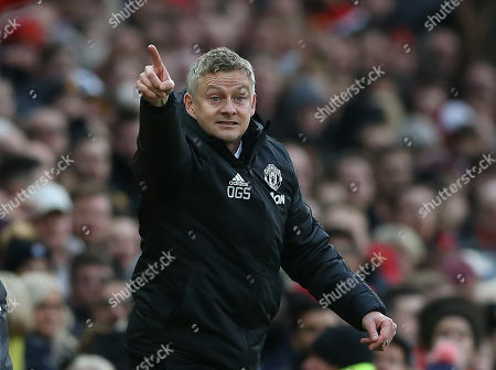 Stock Photo of Manchester United's manager Ole Gunnar Solskjaer reacts during the English Premier League soccer match between Manchester United and Brighton Hove Albion at Old Trafford Stadium in Manchester, Britain, 10 November 2019.