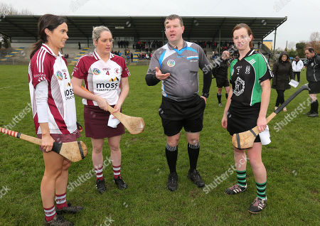 Stock Photo of Clanmaurice (Kerry) vs St. Brendas Ballymacnab (Armagh). Aoibhin O'Hare and Aieen McParland of St.Brenda's with Clanmaurice's Liz Houlihan and referee Kevin O'Brien
