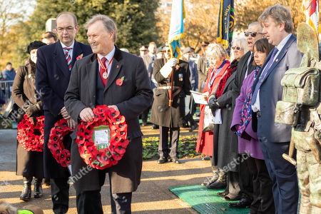 Stock Photo of Sir David Amess and James Dudderidge lay wreaths at the war memorial. Remembrance Day Service at the Southend Cenotaph, Clifftown Parade, in front of the Lutyens designed war memorial. The service is attended by local dignitaries, including the Mayor Southend and both local MPs, Sir David Amess and James Dudderidge.