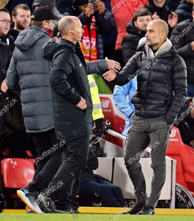 Liverpool manager Juergen Klopp (L) shakes hands with Manchester City manager Pep Guardiola (R) after the English Premier League soccer match between Liverpool FC and Manchester City in Liverpool, Britain, 10 November 2019.