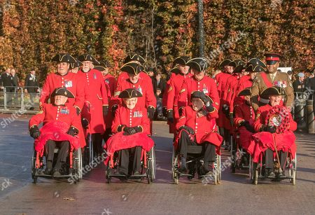 Sergeant Johnson Beharry arrives with Chelsea pensioners and war veterans at Horse Guards Parade in the bright autumn sunshine for the remembrance sunday ceremony