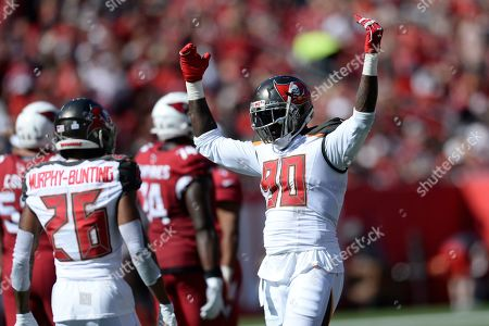 Tampa Bay Buccaneers defensive end Jason Pierre-Paul (90) fires up the crowd against the Arizona Cardinals during the first half of an NFL football game, in Tampa, Fla
