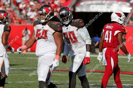 Tampa Bay Buccaneers defensive end Jason Pierre-Paul (90) yells at defensive tackle Vita Vea (50) after a run by Arizona Cardinals running back Kenyan Drake (41) during the second half of an NFL football game, in Tampa, Fla