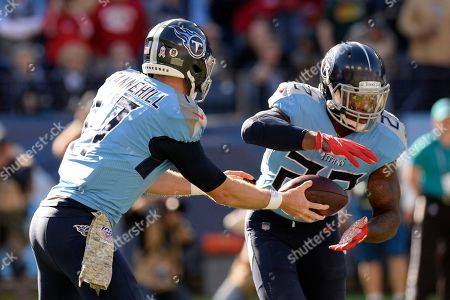 Tennessee Titans quarterback Ryan Tannehill (17) hands off to running back Derrick Henry (22) in the first half of an NFL football game against the Kansas City Chiefs, in Nashville, Tenn
