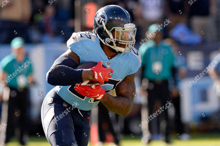 Tennessee Titans running back Derrick Henry carries the ball against the Kansas City Chiefs in the first half of an NFL football game, in Nashville, Tenn