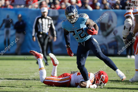 Tennessee Titans running back Derrick Henry (22) gets past Kansas City Chiefs free safety Juan Thornhill as Henry runs 68 yards for a touchdown in the second half of an NFL football game, in Nashville, Tenn