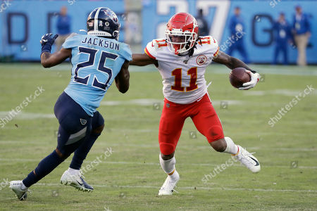 Kansas City Chiefs wide receiver Demarcus Robinson (11) is defended by Tennessee Titans cornerback Adoree' Jackson (25) in the second half of an NFL football game, in Nashville, Tenn. The Titans won 35-32