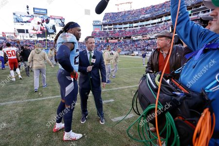 Tennessee Titans running back Derrick Henry is interviewed after an NFL football game against the Kansas City Chiefs, in Nashville, Tenn. The Titans won 35-32