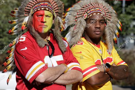 Kansas City Chiefs fans Jeff Stewart, left, and Corey Washington, pose outside Nissan Stadium before an NFL football game between the Tennessee Titans and the Kansas City Chiefs, in Nashville, Tenn