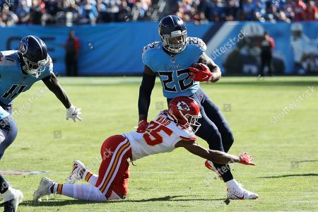 Tennessee Titans running back Derrick Henry (22) is hit by Kansas City Chiefs cornerback Charvarius Ward (35) in the first half of an NFL football game, in Nashville, Tenn