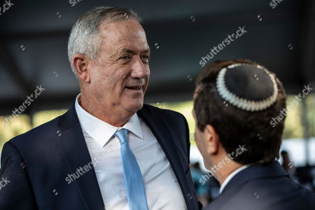 Israeli Blue and White party chief Benny Gantz (L) attends a state memorial ceremony for Yitzhak and Leah Rabin, at Mt. Herzl in Jerusalem, 10 November 2019. Yitzhak Rabin was shot dead on 04 November 1995 just two years after the signing of the Oslo peace accords, for which he and former Israeli president Shimon Peres were awarded the Nobel Peace Prize along with late veteran Palestinian leader Yasser Arafat.
